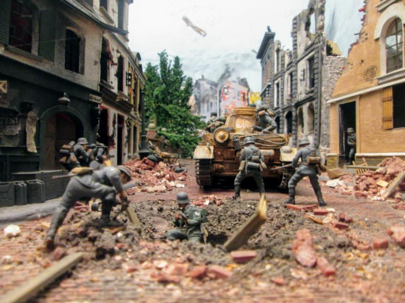 You can learn some history at Miniature World. Here's a scene of WWII's The Battle of Caen.